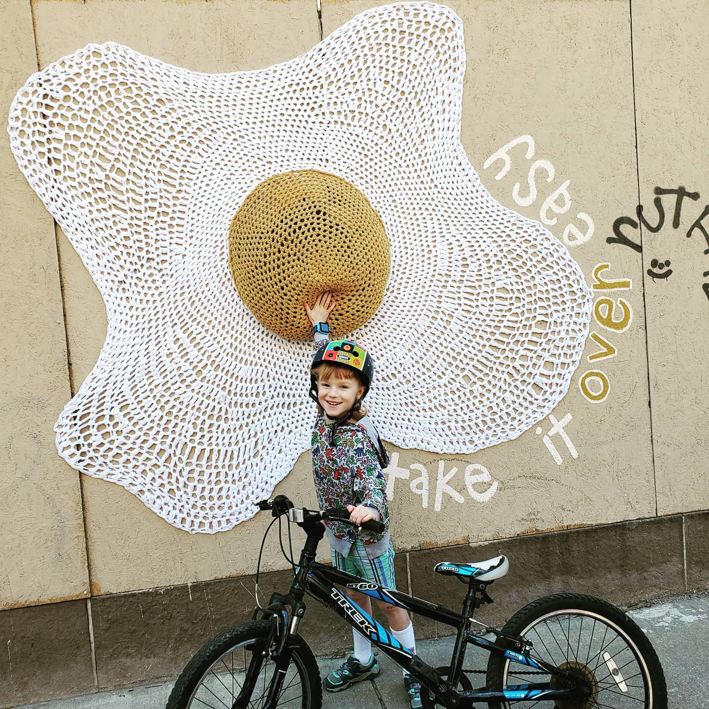 take it over easy. littlest one, thrilled for gears + a ride into Center City